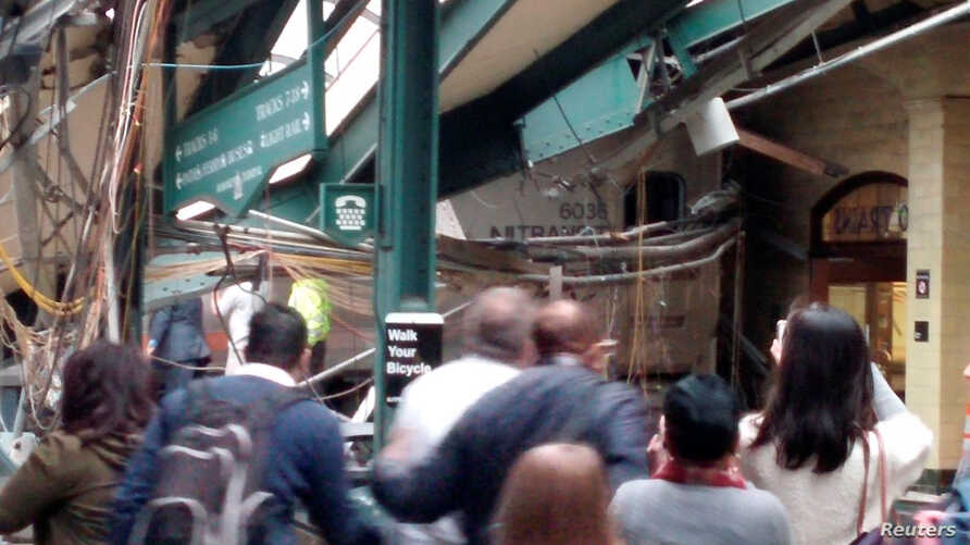 Onlookers view a New Jersey Transit train that derailed and crashed through the station in Hoboken, New Jersey, U.S. in this picture courtesy of Chris Lantero taken Sept. 29, 2016.