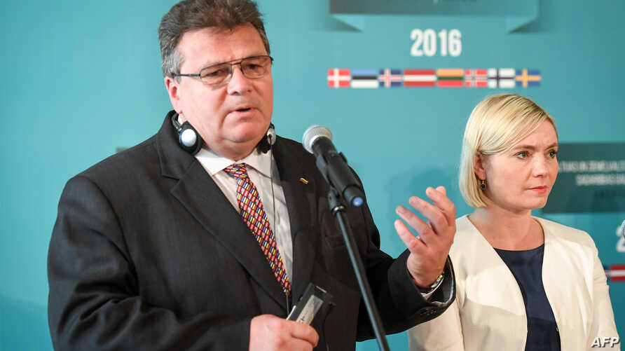 Lithuania's Foreign Minister Linas Linkevicius (L) and Island's Foreign Minister Lilja Alfredsdottir (R) give a press conference after the Baltic and Nordic Foreign Ministers meeting in Riga, Latvia, on August 26, 2016.