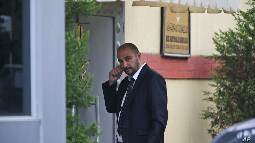 """A security guard walks outside Saudi Arabia's consulate in Istanbul, Oct. 20, 2018. Saudi Arabia claims Saudi journalist Jamal Khashoggi died in a """"fistfight"""" in the consulate, finally admitting that the writer had been slain at its diplomatic post."""