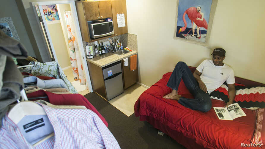 Jon-Christian Stubblefield relaxes inside of his 200 square foot Mini-Suite apartment in the First Hill neighborhood in Seattle, Washington May 12, 2013.