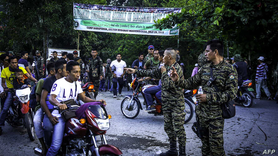 Moro Islamic Liberation Front (MILF) members secure Camp Darapanan on the southern island of Mindanao, July 29, 2018. Nearly 100,000 members of the Philippines' largest Muslim rebel group gathered to discuss a landmark law granting them autonomy, ex...