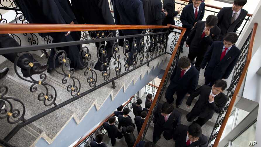 Students at the Pyongyang University of Science and Technology descend stairs after a seminar and lecture, Oct. 5, 2011.