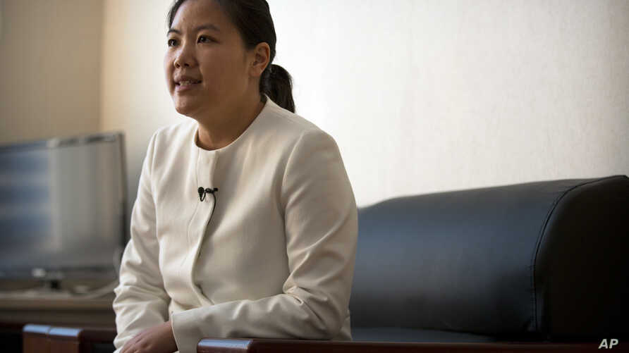 Xu Yan, the wife of Chinese lawyer Yu Wensheng, speaks during an interview in their apartment on the outskirts of Beijing, Jan. 19, 2018.