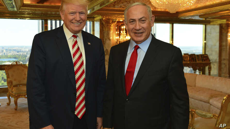 FILE - photo provided by Israeli Government Press Office - then-Republican Presidential candidate Donald Trump meets Israeli Prime Minister Benjamin Netanyahu in New York.