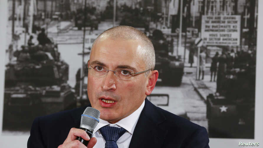 Freed Russian former oil tycoon Mikhail Khodorkovsky speaks during his news conference at the Museum Haus in Berlin, Dec. 22, 2013.