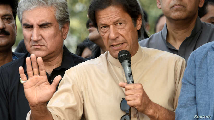 """Pakistani opposition leader Imran Khan talks to media outside his house in Islamabad, Pakistan, November 1, 2016. Instead of a protest, Khan plans a celebration after the Supreme Court's decision to look into the """"Panama Papers."""""""