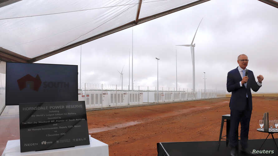 South Australian Premier Jay Weatherill speaks as he stands next to a plaque during the official launch of the Hornsdale Power Reserve, featuring the world's largest lithium ion battery made by Tesla, near the South Australian town of Jamestown, Dec.