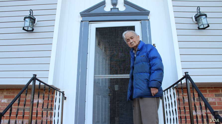 Gerardo Tan, pictured at his Maryland home, is still waiting for compensation that was promised to him for serving as a Filipino soldier during World War II when the Philippines was a U.S. territory. (I. Basco/VOA)