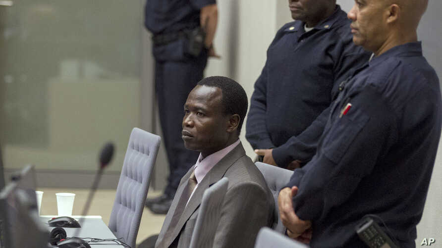 Dominic Ongwen, center, a senior commander in the Lord's Resistance Army, whose fugitive leader Kony is one of the world's most-wanted war crimes suspects, sits in the court room of the International Court in The Hague, Jan. 21, 2016.