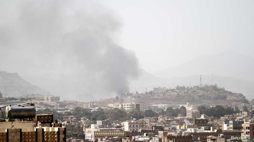 Smoke rises after an airstrike in Sanaa, Yemen, March 22, 2018.