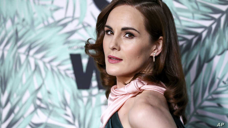 """FILE - In this Feb. 24, 2017, file photo, Michelle Dockery arrives at the 10th Annual Women in Film Pre-Oscar Cocktail Party at Nightingale Plaza in Los Angeles. Filming has begun for the """"Downtown Abbey"""" movie. Dockery, who plays Lady Mary in the gl"""