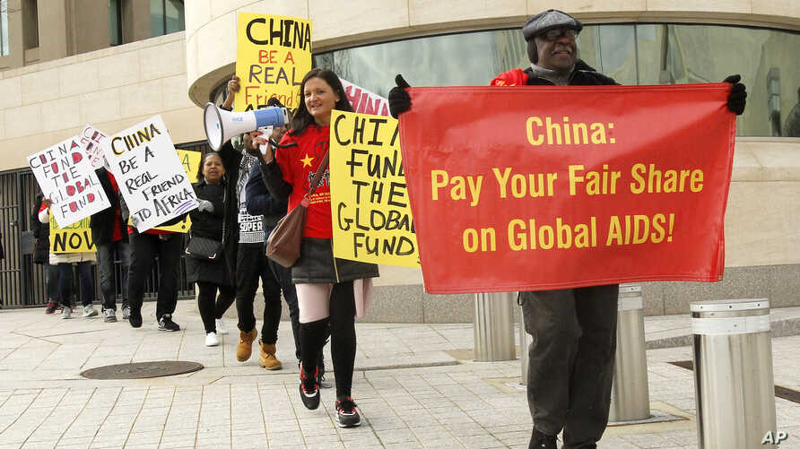 """Advocates from the AIDS Healthcare Foundation and other community organizations demonstrate outside the Chinese Embassy, Jan. 28, 2017 in Washington, DC. The demonstration is part of the """"Fund the Fund"""" advocacy campaign, which calls on China, the wo"""