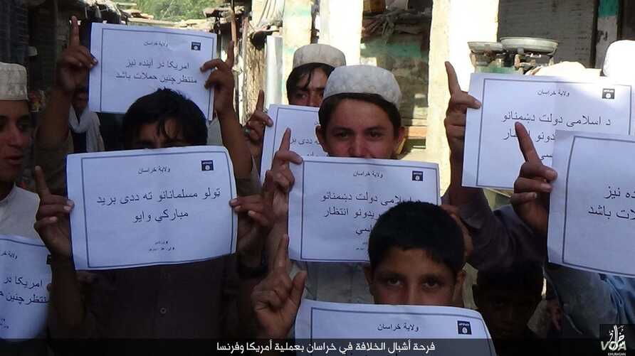 "IS social media distributed photos in several languages of children holding placards in Islamic State territories offering ""congratulations"" on the deaths of Americans, apparently in reference to the Orlando mass shooting on June 12, 2016."