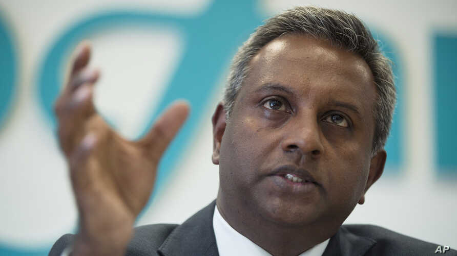"""Amnesty International Secretary General Salil Shetty presents the Amnesty International report """"Abductions and torture in Eastern Ukraine"""" during a news conference in Moscow, Russia, Sept. 10, 2014."""