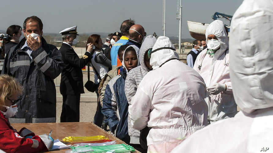 Rescued migrants arrive at the southern Italian port of Corigliano, Italy, April 15, 2015.