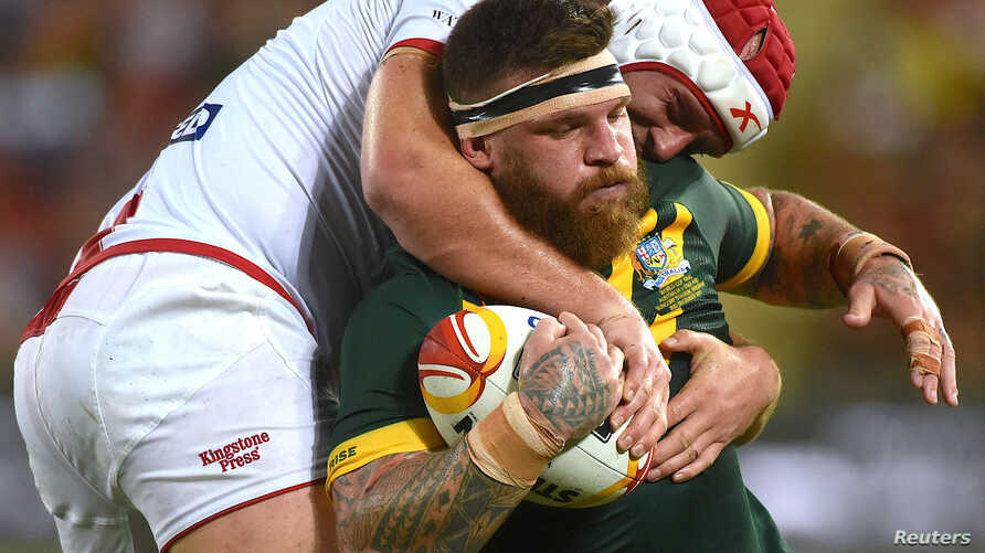 FILE - England's Chris Hill tackles Australia's Josh Mcguire during а match of the Rugby League World Cup, in Land Park, Brisbane, Australia, Dec. 2, 2017.