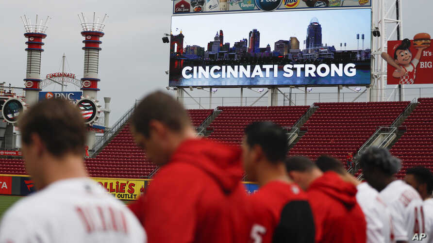 A moment of silence is observed for the dead and wound in a shooting downtown, at Great American Ball Park before a baseball game between the Cincinnati Reds and the San Diego Padres, Sept. 6, 2018, in Cincinnati.