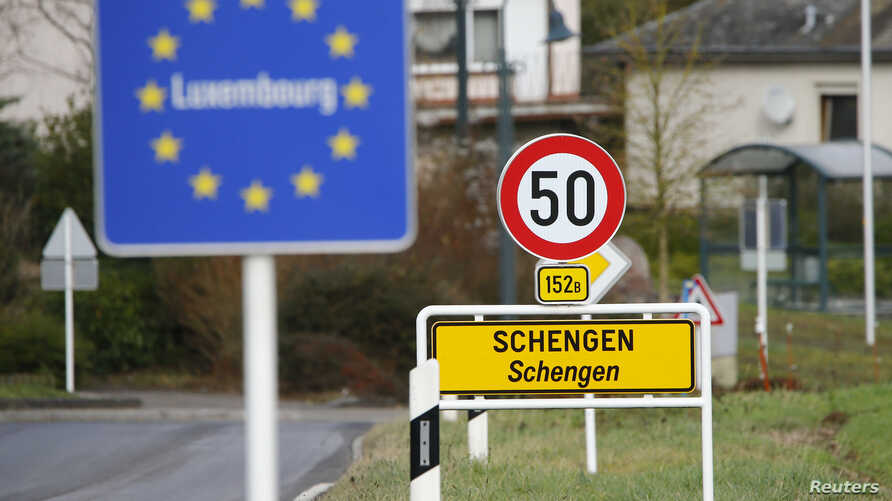 A street sign marks the beginning of Schengen, Luxembourg January 27, 2016. The Schengen Agreement with the goal to illiminate internal border controls was signed on June 14, 1985 in the small village at the river Moselle and the tripoint of France,