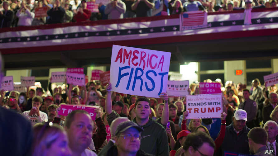 Supporters of Republican presidential candidate Donald Trump listen to him speak during a campaign rally at Lackawanna College,  Nov. 7, 2016, in Scranton, Pa.