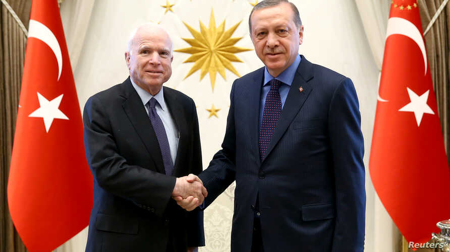 Turkish President Tayyip Erdogan, right, meets with U.S. Senator John McCain at the Presidential Palace in Ankara, Feb. 20, 2017.