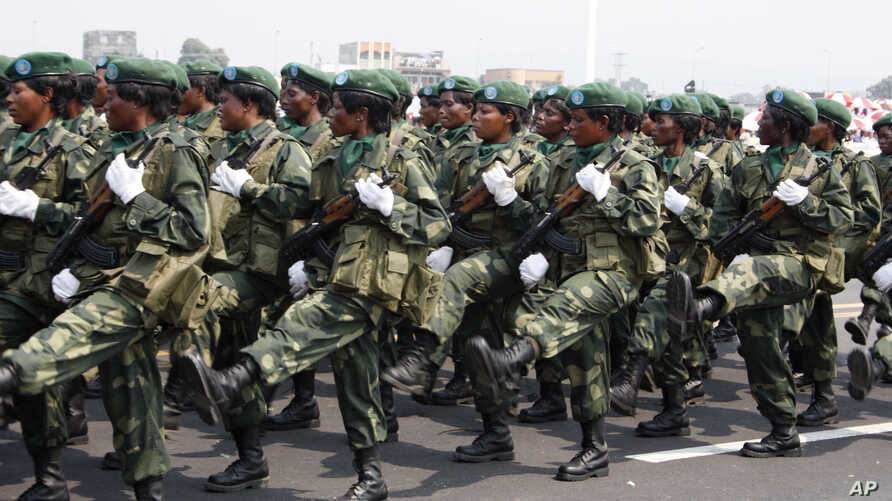 Female soldiers march in a parade as part of celebrations of Congo's 50th anniversary of independence, in Kinshasa, Congo Wednesday, June 30, 2010. Congo's government marked the anniversary on Wednesday with pomp and circumstance, and the invited gue