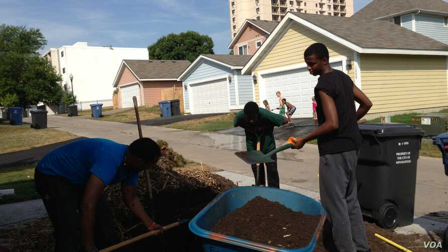 Zacharia Yusuf Abdurahman does volunteer work for Habitat for Humanity in northern Minneapolis as a teenager.