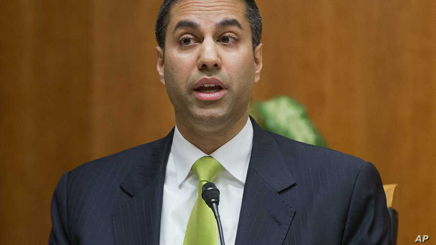 FILE - Federal Communication Commission Commissioner Ajit Pai speaks during a hearing in Washington.