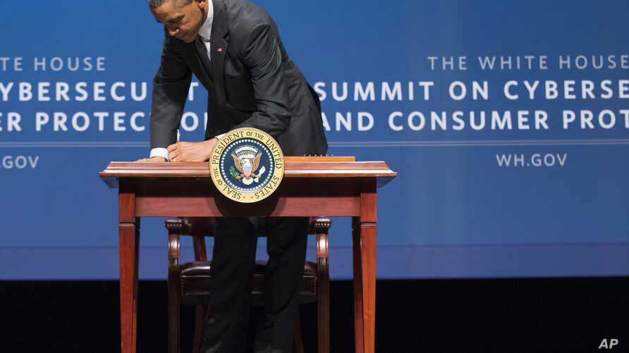 President Barack Obama signs an executive order promoting private sector cybersecurity information sharing during a summit on cybersecurity and consumer protection, Feb. 13, 2015, at Stanford University in Palo Alto, California.
