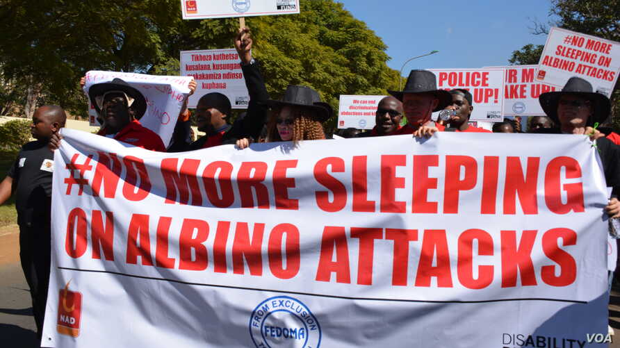 FILE - Petitioners march to Malawi parliament to protest attacks on Albinos in the country. (Photo: L. Masina/VOA)