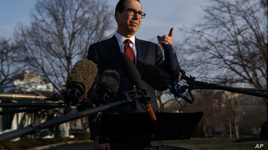 Treasury Secretary Steve Mnuchin speaks with reporters outside the White House, Feb. 6, 2019.
