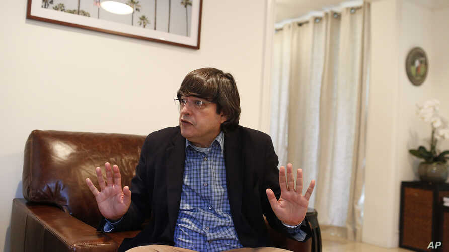 In this Dec. 4, 2018 photo, Jaime Bayly speaks during an interview in Key Biscayne, Florida.