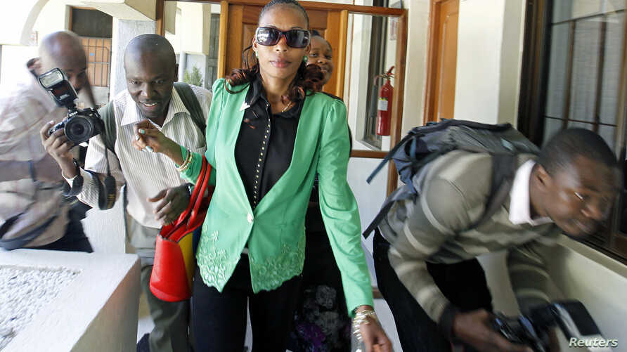 Kenyan marathon runner Rita Jeptoo walks past photographers as she arrives at the Athletics Kenya headquarters after failing a doping test, in Kenya's capital Nairobi, January 15, 2015.