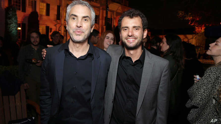 """Writer-director Jonas Cuaron and his father, Oscar-winning filmmaker Alfonso Cuaron, are seen at STX Entertainment's premiere of """"Desierto"""" at the 2016 L.A. Film Festival's closing night in Culver City, Calif., June 9, 2016."""