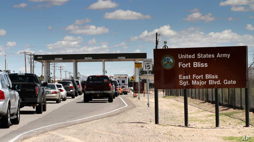 FILE - This Sept. 9, 2014 file photo shows cars wait to enter Fort Bliss in El Paso, Texas.