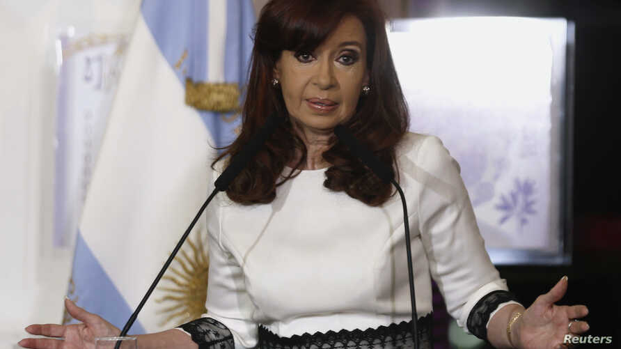 Argentina's President Cristina Fernandez de Kirchner speaks during a ceremony at the Casa Rosada Presidential Palace in Buenos Aires July 31, 2014. Argentina's bond and stock markets and peso currency dropped on Thursday after Latin America's No. 3 e
