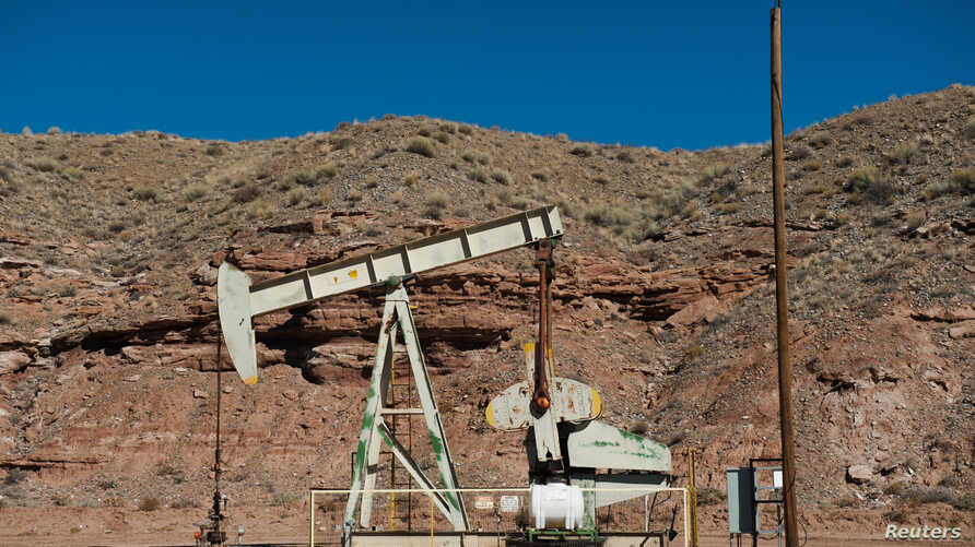 Oil pump jacks are seen near Aneth, Utah, Oct. 29, 2017.