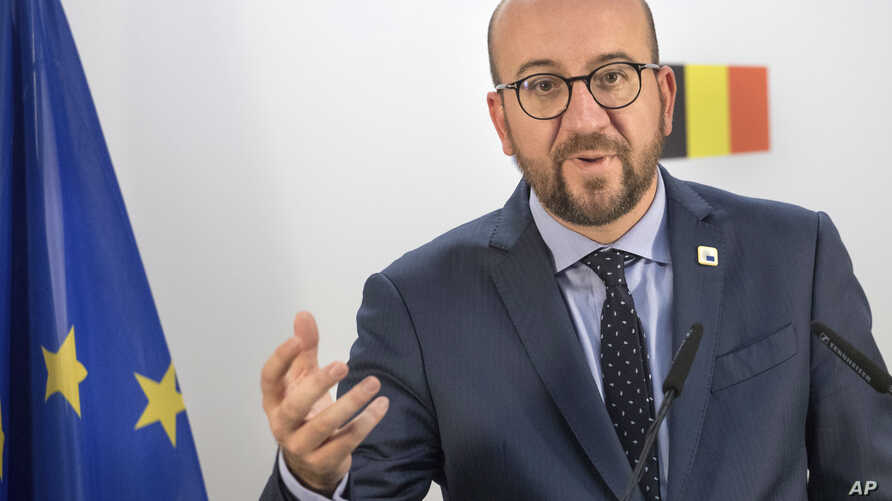Belgian Prime Minister Charles Michel holds a press conference on the second day of the EU summit in Brussels, Oct. 21, 2016.