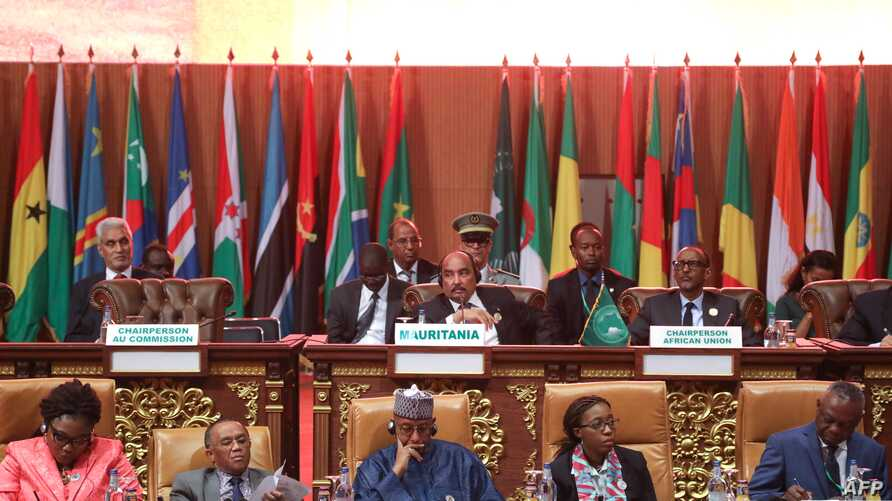 Mauritanian President Mohamed Ould Abdel Aziz, Rwandan President Paul Kagame and African Union Commission Secretary General Mourad Ben Dhiab,  sit with delegates at the plenary session of the 31st Ordinary Session of the Assembly of African Union (AU