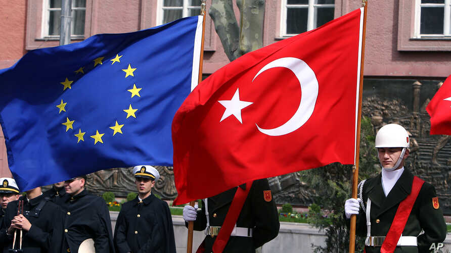 FILE - A Turkish guard of honor hold an EU flag and a Turkish flag in Ankara, Turkey, April 10, 2008.