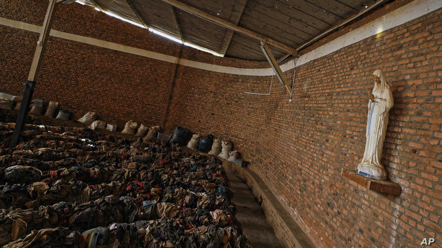 Piles of clothes belonging to some of those who were slaughtered as they sought refuge inside the church cover the pews as a memorial to the thousands who were killed during the 1994 genocide in and around the Catholic church in Nyamata, Rwanda, Apri