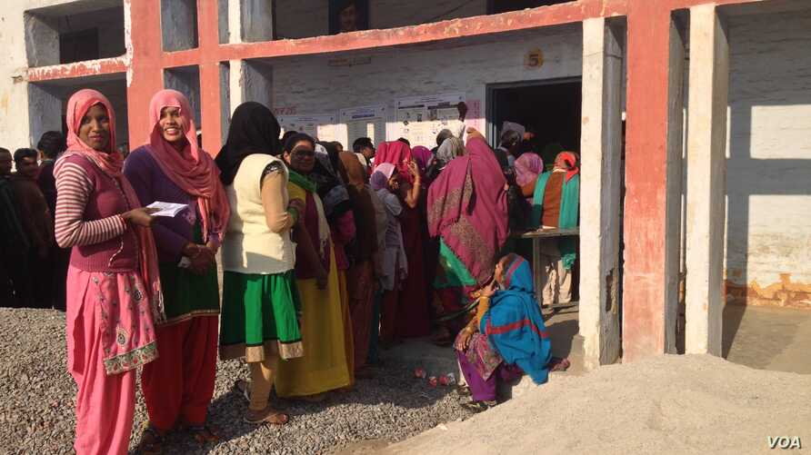 Women in Uttar Pradesh turn out enthusiastically to vote, but many cast ballots as they are instructed to by men in the family. (A. Pasricha/VOA)