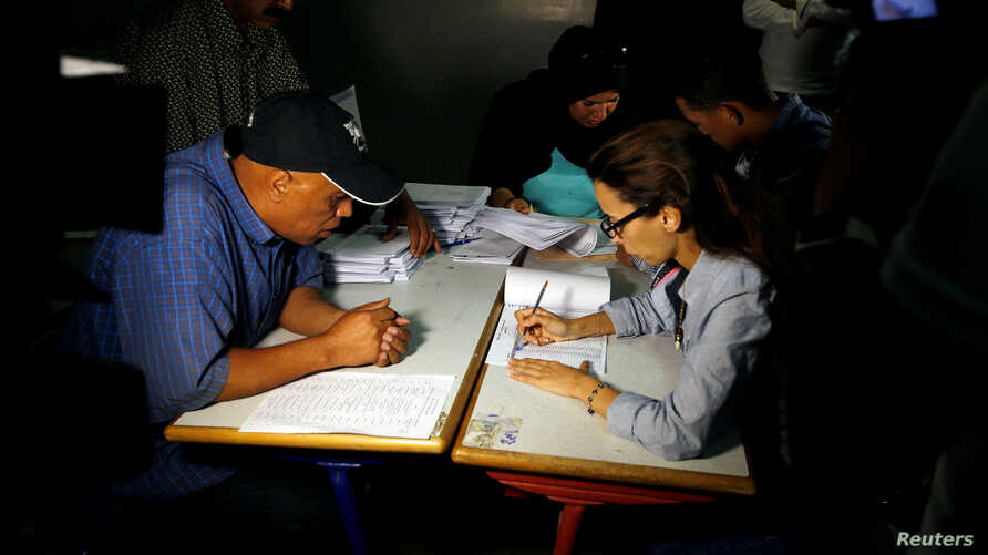 Officials count ballots after polls have been closed at a polling station in Rabat, Morocco, on October 7, 2016.