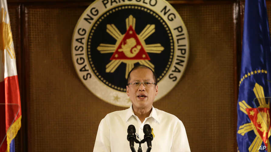 Philippine President Benigno Aquino III addresses the nation in a live broadcast from the Presidential Palace in Manila, July 14, 2014.