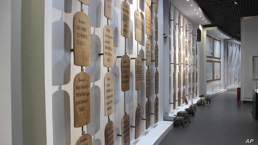 A wall of Quranic inscriptions hangs in a gallery dedicated to Abrahamic religions in Africa, seen in a Museum of Black Civilizations in Dakar, Senegal, Dec. 20, 2018.