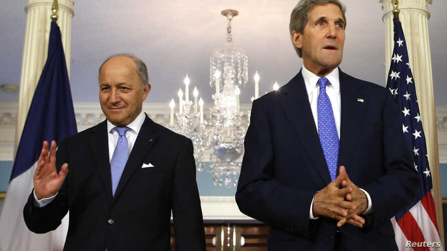 FILE - U.S. Secretary of State John Kerry (R) and French Foreign Minister Laurent Fabius