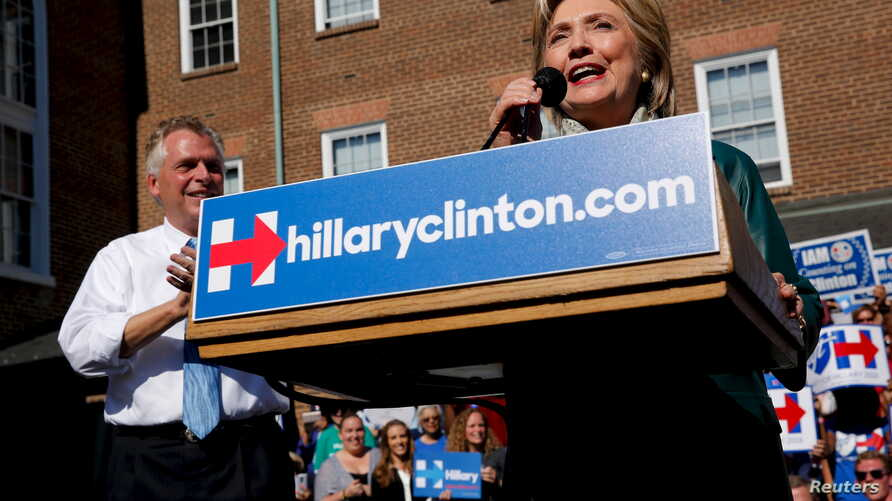 Democratic presidential candidate Hillary Clinton takes the stage for a rally with Virginia Governor Terry McAuliffe in Alexandria, Virginia, Oct. 23, 2015.