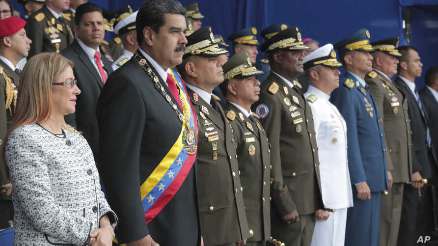 Photo provided by the Miraflores Presidential Palace shows President Nicolas Maduro (2nd-L) and firsts Lady Cilia Flores during a event marking the 81th anniversary of the National Guard, in Caracas, Venezuela, August 4, 2018.
