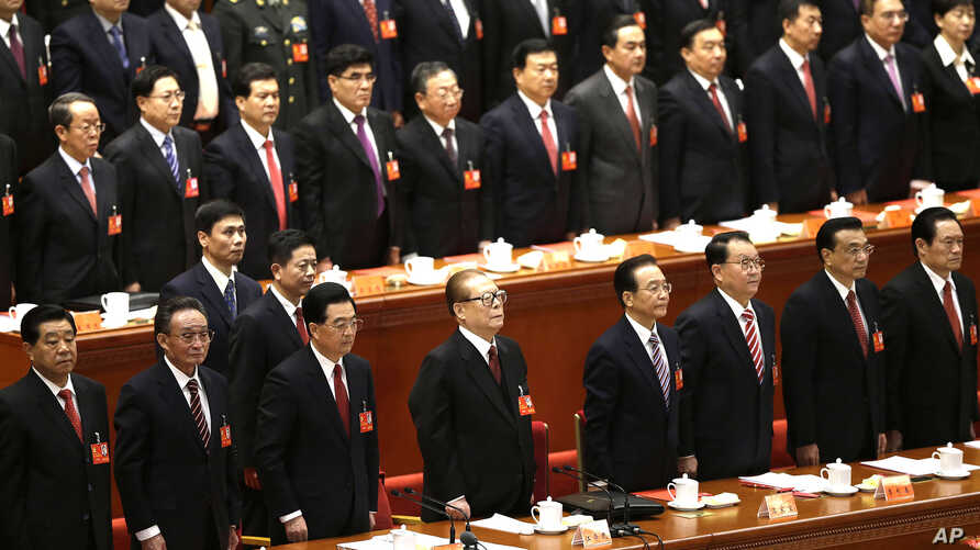Leading party members including outgoing president Hu Jintao, (3rd left), stand singing of the Internationale, the international communist anthem, at the closing ceremony of the 18th Communist Party Congress held at the Great Hall of the People in Be