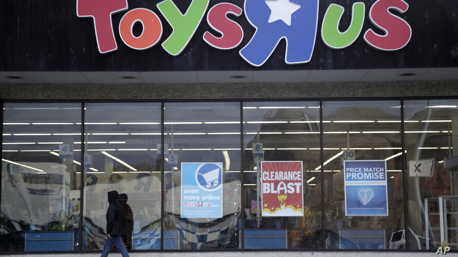 A person walks near the entrance to a Toys R Us store, Jan. 24, 2018, in Wayne, New Jersey.