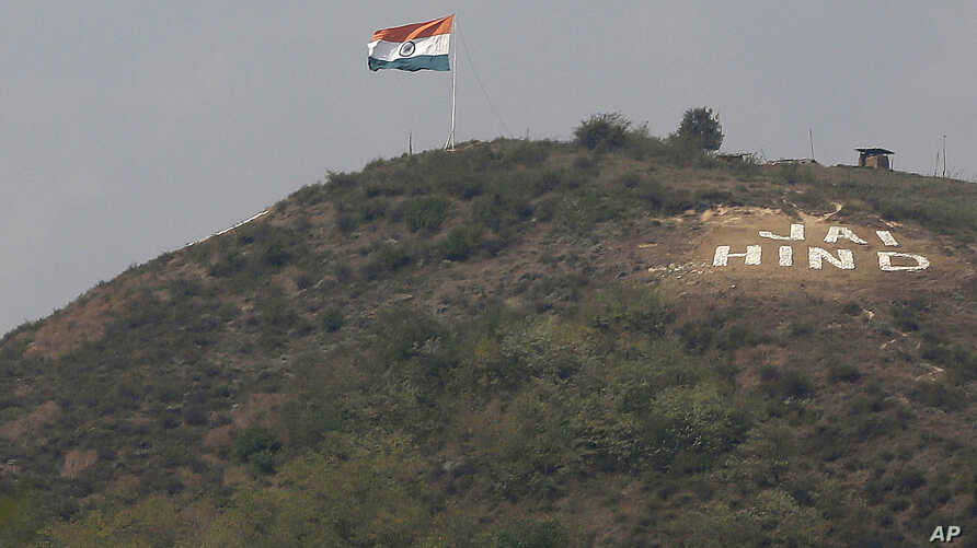 "FILE - An Indian flag flies on a hill in the Uri sector, near the de facto border dividing Kashmir between India and Pakistan, in Indian-controlled Kashmir, Sept. 21, 2016. ""Jai Hind"" roughly translates into ""Long live India."""